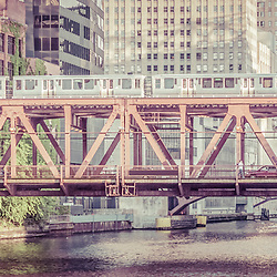 Chicago Lake Street Bridge L Train retro picture of a train crossing the over the Chicago River in downtown Chicago. Panoramic picture ratio is 1:3.
