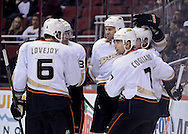 Mar. 1, 2013; Glendale, AZ, USA; Anaheim Ducks  forward Andrew Cogliano (7) is congratulated by defensemen Ben Lovejoy (6) , defensemen Toni Lydman (32) and forward Daniel Winnik (34) after scoring against Phoenix Coyotes in the first period at Jobing.com Arena. Mandatory Credit: Jennifer Stewart-USA TODAY Sports