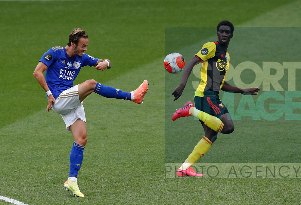 James Maddison of Leicester City clips the field up field past Ismaila Sarr of Watford during the Premier League match at Vicarage Road, Watford. Picture date: 20th June 2020. Picture credit should read: Darren Staples/Sportimage