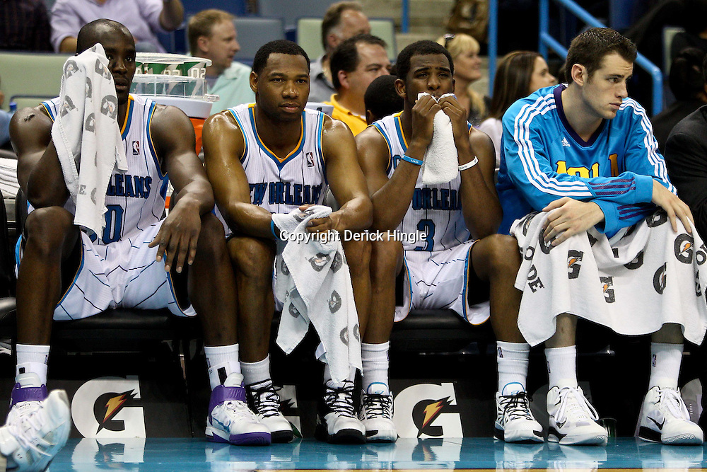 April 1, 2011; New Orleans, LA, USA; New Orleans Hornets players (left to right) Emeka Okafor, Willie Green, Chris Paul and Jason Smith during the fourth quarter against the Memphis Grizzlies at the New Orleans Arena. The Grizzlies defeated the Hornets 93-81.   Mandatory Credit: Derick E. Hingle