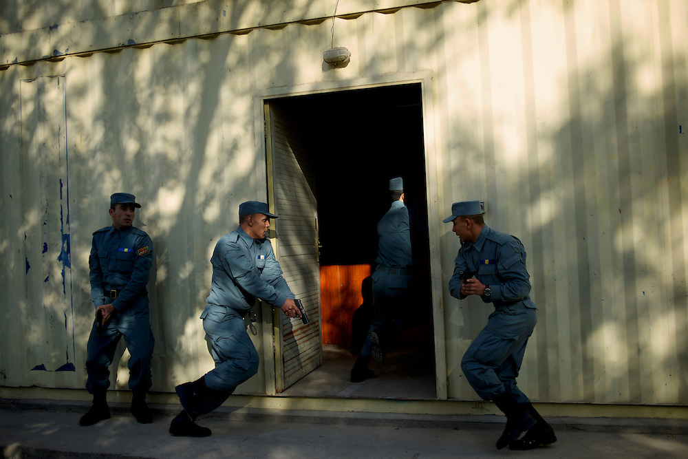 Afghan National Police (ANP) cadets simulate a raid to a Taliban house during combat exercises at the Afghan Nacional Police Academy in Kabul.