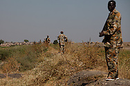 SPLA troops take up position facing SAF forces across the border in South Sudan's most northern barracks in Upper Nile State.