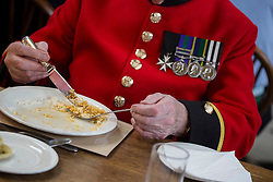 © licensed to London News Pictures. London, UK 02/10/2012. Chelsea Pensioners eating curry as they launch The Soldiers' Charity Big Curry season with a special curry lunch at Royal Hospital Chelsea's Royal Hall in London on 02/10/12. Photo credit: Tolga Akmen/LNP