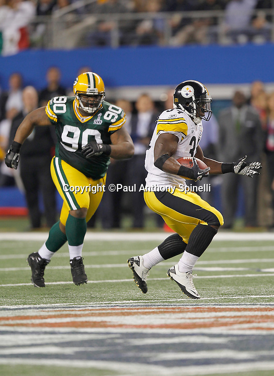 Pittsburgh Steelers running back Rashard Mendenhall (34) catches a pass for a short gain while being chased by Green Bay Packers defensive tackle B.J. Raji (90) during Super Bowl XLV against the Green Bay Packers on Sunday, February 6, 2011, in Arlington, Texas. The Packers won the game 31-25. ©Paul Anthony Spinelli
