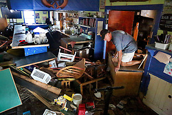 October 9, 2016 - Crescent Beach, Florida, U.S. - DOUGLAS R. CLIFFORD   |   Times.Jerry Galasso, 65, co-owner of the Mantanzas Innlet Restaurant, 8805 A1A S, in St. Augustine, FL, crawls out of the restaurant's kitchen while surveying damage to the restaurant on Saturday (108/16) after it was gutted and destroyed by Hurricane Matthew as it passed off Florida's east coast. (Credit Image: © Douglas R. Clifford/Tampa Bay Times via ZUMA Wire)