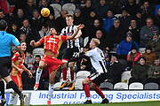 MK Dons forward Osman Sow (9) in air with Grimsby Town defender Luke Hendrie (27) as Grimsby Town defender Ludvig Ohman (5) pulls on shorts of Grimsby Town forward Jonathan Hooper(9) during the EFL Sky Bet League 2 match between Grimsby Town FC and Milton Keynes Dons at Blundell Park, Grimsby, United Kingdom on 26 January 2019.