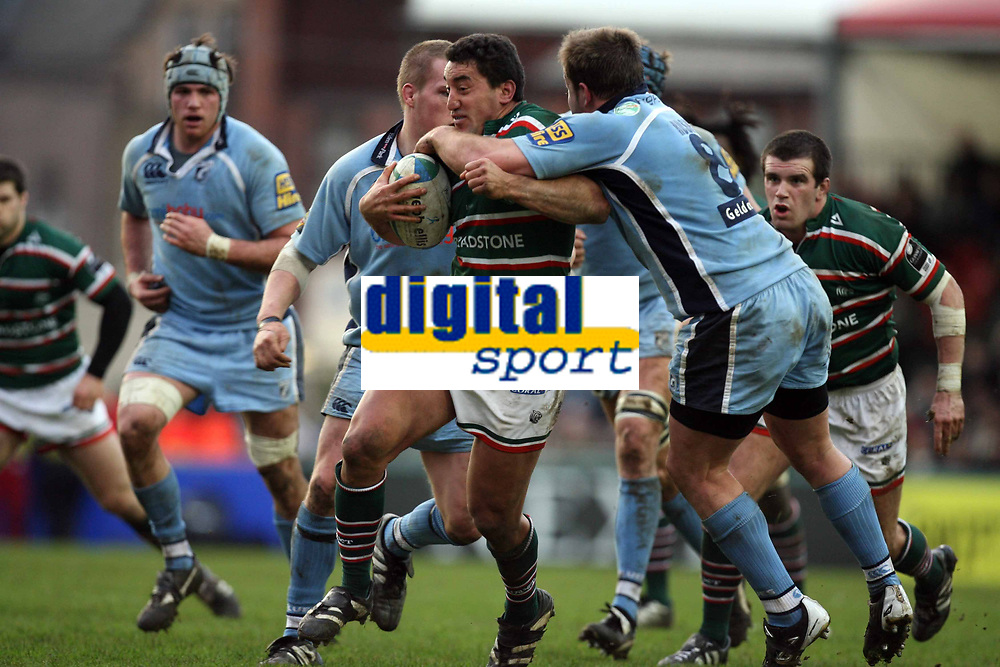 Photo: Rich Eaton.<br /> <br /> Leicester Tigers v Cardiff Blues. Heineken Cup. 13/01/2007. Daryl Gibson attacks for Leicester tackled by Xavier Rush right of Cardiff