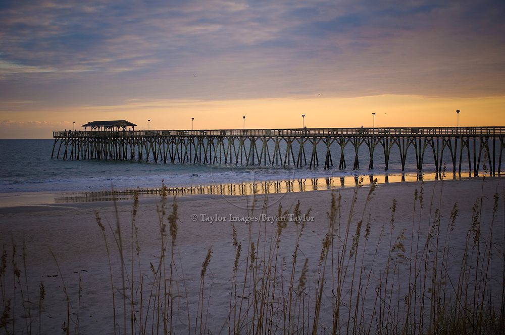 Sea, oats, and sunrise on the pier in Myrtle Beach, South Carolina