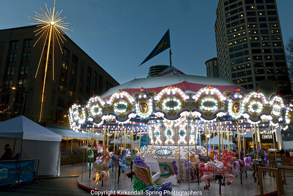 WA09411-00...WASHINGTON - Christmas carrousel in Seattle's WestLake Park.