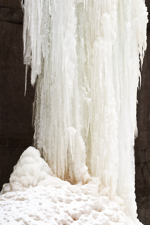 As waterfalls freeze, they form intricate pillars of ice that create beautiful winter landscape designs.