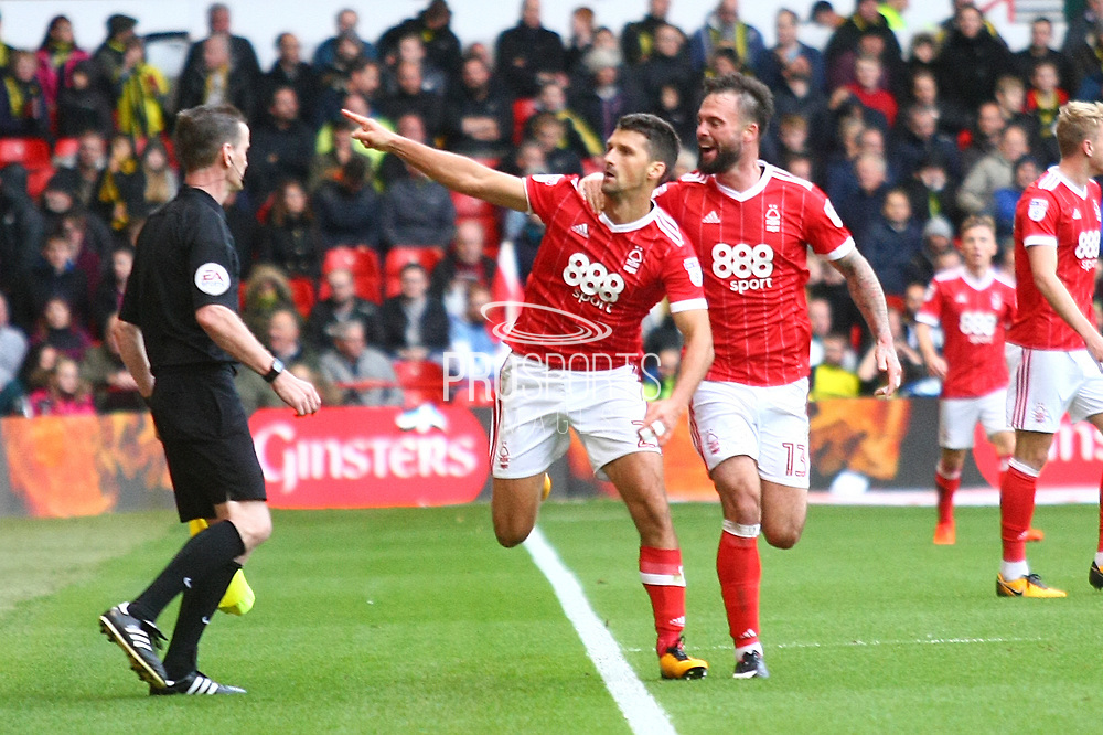 Nottingham Forest defender Eric Lichaj (2) scores a goal and celebrates with Nottingham Forest defender Danny Fox (13) , 2-0,  during the EFL Sky Bet Championship match between Nottingham Forest and Burton Albion at the City Ground, Nottingham, England on 21 October 2017. Photo by John Potts.