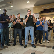 FORT LAUDERDALE, FLORIDA, DECEMBER 21, 2015<br /> Supporters of suspended Broward Sheriff's deputy Peter Peraza, mostly plain clothes and some uniformed police officers, clap in support of the officer outside the courtroom. This was following a brief court appearance by Peraza and his criminal defense attorney. Peraza faces manslaughter charges in the shooting death of Jermaine McBean, 33, in July of 2013.<br /> (Photo by Angel Valentin/Freelance).