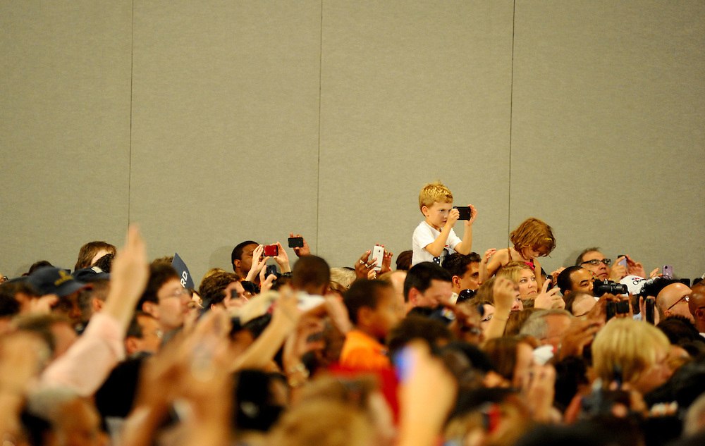 LAURA FONG | SUMMER KENT STATER Obama supporters of all ages snap photos and record video on their phones as the President takes the stage at the John S. Knight Center Wednesday.