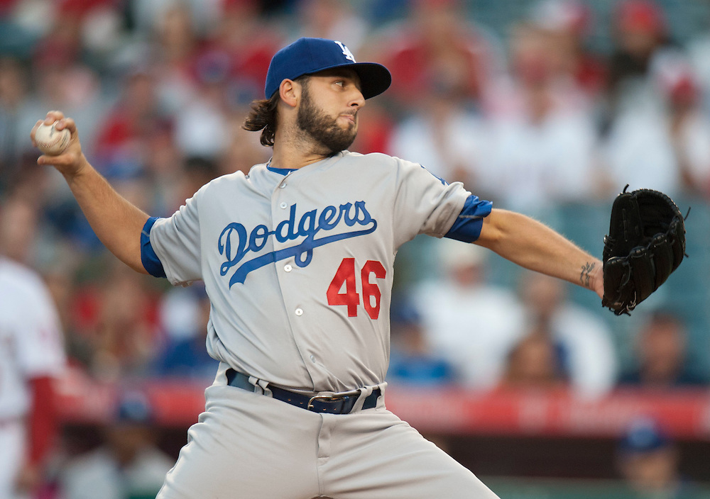 Dodgers starting pitcher Mike Bolsinger throws against the Angels Wednesday night at Angel Stadium.<br /> <br /> ///ADDITIONAL INFO:   <br /> <br /> angels.0519.kjs  ---  Photo by KEVIN SULLIVAN / Orange County Register  -- 5/18/16<br /> <br /> The Los Angeles Angels take on the Los Angeles Dodgers in inter-league play at Angel Stadium Wednesday night.