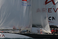 France's Areva Challenge crew packs spinnaker after intense afternoon of America's Cup fleet racing; Valencia, Spain.