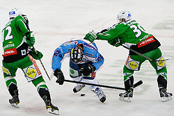 Eric Pance (HDD Tilia Olimpija, #30) and Petr Sachl (HDD Tilia Olimpija, #12) vs Krisztian Palkovics (SAPA Fehervar AV19, #24) during ice-hockey match between HDD Tilia Olimpija and SAPA Fehervar AV19 at second match in Quarterfinal  of EBEL league, on Februar 21, 2012 at Hala Tivoli, Ljubljana, Slovenia. HDD Tilia Olimpija won 2:1 in OT. (Photo By Matic Klansek Velej / Sportida)
