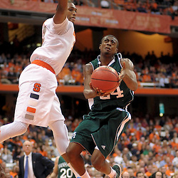 Manhattan Jaspers guard/forward George Beamon (24) glides to the hoop under the hand of Syracuse Orange forward Kris Joseph (32) in the first half at the Carrier Dome in Syracuse, NY. The fifth ranked Syracuse Orange defeated the Manhattan Jaspers 92-56 in the first round of the NIT (National Invitation Tournament) Season Tipoff Tournament.