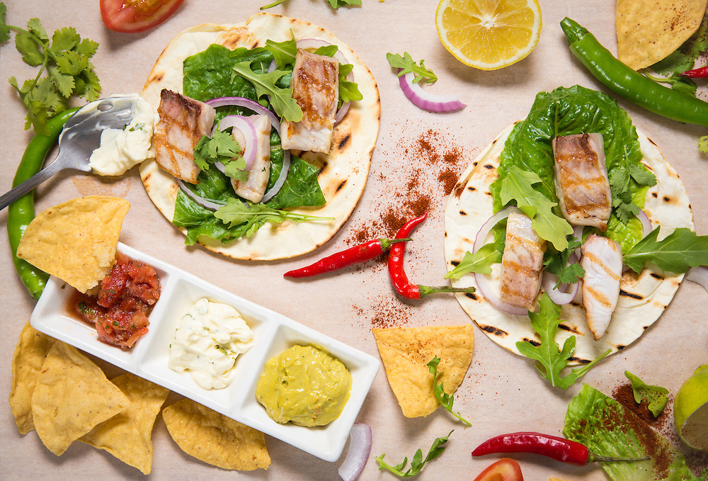 Fish tacos and various ingredients.