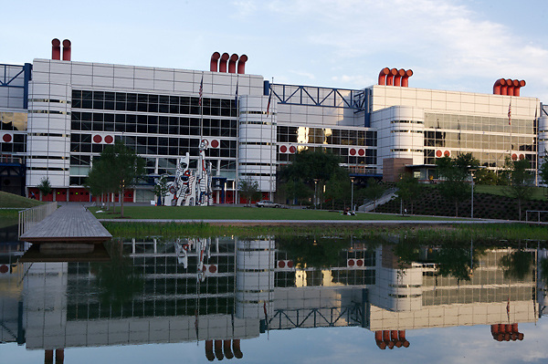 Stock photo of the George R. Brown Convention Center reflected in the water from across the park's pond