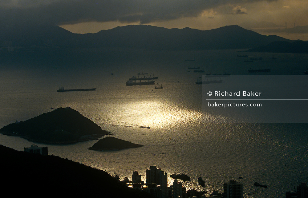 Aerial landscape of Lantau Island and cargo shipping at anchor in West Lamma Channel.