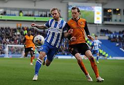 Brighton and Hove Albion's Craig Mackail-Smith is tackled by Wolverhampton Wanderers' Richard Stearman  - Photo mandatory by-line: Harry Trump/JMP - Mobile: 07966 386802 - 14/03/15 - SPORT - Football - Sky Bet Championship - Brighton v Wolves - Amex Stadium, Brighton, England.
