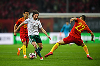Yu Dabao, right, of Chinese national men's football team challenges Joe Allen of Wales national football team in the semi-final match during the 2018 Gree China Cup International Football Championship in Nanning city, south China's Guangxi Zhuang Autonomous Region, 22 March 2018.