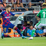 BARCELONA, SPAIN - August 25:  Carles Perez #27 of Barcelona defended by Cristian Tello #11 of Real Betis during the Barcelona V  Real Betis, La Liga regular season match at  Estadio Camp Nou on August 25th 2019 in Barcelona, Spain. (Photo by Tim Clayton/Corbis via Getty Images)