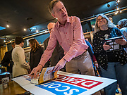 11 MAY 2019 - DAVENPORT, IOWA: JOHN HICKENLOOPER, the former Governor of Colorado, signs autographs after a campaign event at Baked Beer and Bread, a microbrew/bakery in Davenport. Gov. Hickenlooper met with voters in Davenport Saturday. He is campaigning in Iowa this weekend to be the Democratic party's nominee for the US Presidency. Iowa traditionally hosts the the first election event of the presidential selection cycle. The Iowa Caucuses will be on Feb. 3, 2020.          PHOTO BY JACK KURTZ