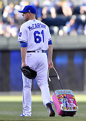 June 20, 2017 - Kansas City, MO, USA - Kansas City Royals pitcher Kevin McCarthy travels to the bullpen pulling a My Little Pony suitcase before a game against the Boston Red Sox at Kauffman Stadium in Kansas City, Mo., on Tuesday, June 20, 2017. (Credit Image: © John Sleezer/TNS via ZUMA Wire)