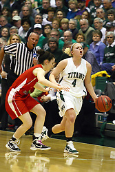 18 March 2011:  Brittany Hasselbring shouts out a play call as she moves up the court during an NCAA Womens basketball game between the Washington University Bears and the Illinois Wesleyan Titans at Shirk Center in Bloomington Illinois.