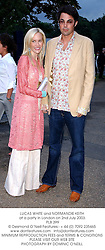 LUCAS WHITE and NORMANDIE KEITH at a party in London on 2nd July 2003. <br /> PLB 399