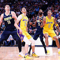 09 March 2018: Los Angeles Lakers guard Lonzo Ball (2) vies for the rebound with Denver Nuggets center Nikola Jokic (15) and Los Angeles Lakers forward Kyle Kuzma (0) vies for the rebound with Denver Nuggets forward Will Barton (5) during the Denver Nuggets125-116 victory over the Los Angeles Lakers, at the Pepsi Center, Denver, Colorado, USA.