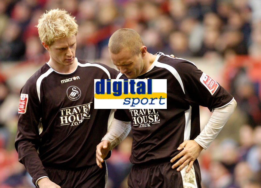 Photo: Leigh Quinnell.<br /> Nottingham Forest v Swansea. Coca Cola League 1. 11/02/2006. Swanseas Alan Tate checks to see if  Lee Trundle is o.k after hurting himself whilst scoring a goal.