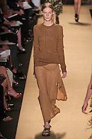 Julia Nobis walks the runway wearing Michael Kors Spring 2012 Collection during Mercedes-Benz Fashion Week in New York on September 14, 2011