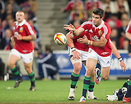 Conor Murray (Lions) passes during the tour match of the 2013 British And Irish Lions Australian Tour between RaboDirect Melbourne Rebels vs British And Irish Lions at AAMI Park, Melbourne, Victoria, Australia. 25/06/0213. Photo By Lucas Wroe