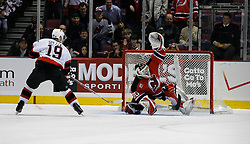 Apr 3, 2007; East Rutherford, NJ, USA; New Jersey Devils goalie Martin Brodeur (30) makes a save on Ottawa Senators center Jason Spezza (19) during the shootout at Continental Airlines Arena in East Rutherford, NJ.