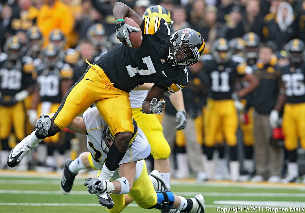 November 05, 2011: Iowa Hawkeyes wide receiver Marvin McNutt (7) tries to avoid Michigan Wolverines safety Jordan Kovacs (32) during the first quarter of the NCAA football game between the Michigan Wolverines and the Iowa Hawkeyes at Kinnick Stadium in Iowa City, Iowa on Saturday, November 5, 2011. Iowa defeated Michigan 24-16.