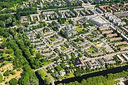 Nederland, Noord-Holland, Amsterdam, 14-06-2012; zuidelijk deel van de wijk Slotervaart met in het midden het complex van De Drie Hoven (gecombineerd verpleeghuis en verzorgingshuis, architect Herman Hertzberger). Boven in beeld de Cormelis Lelylaan rechts het Sierplein en  Johan Huizingalaan. .De wijk is onderdeel van de Westelijke Tuinsteden, gerealiseerd op basis van het Algemeen Uitbreidingsplan voor Amsterdam (AUP, 1935). Voorbeeld van het Nieuwe Bouwen, open bebouwing in stroken, langwerpige bouwblokken afgewisseld met groenstroken. .This residential area Slotervaart is an example of garden cities of Amsterdam-west. Constructed on the basis of the General Extension Plan for Amsterdam (AUP, 1935). Example of the New Building (het Nieuwe Bouwen), detached in strips, oblong housing blocks alternated with green areas, built in fifties and sixties of the 20th century. Nursing  and care home (high-rise, middle) has been built by architect Herman Hertzberger..luchtfoto (toeslag), aerial photo (additional fee required).foto/photo Siebe Swart