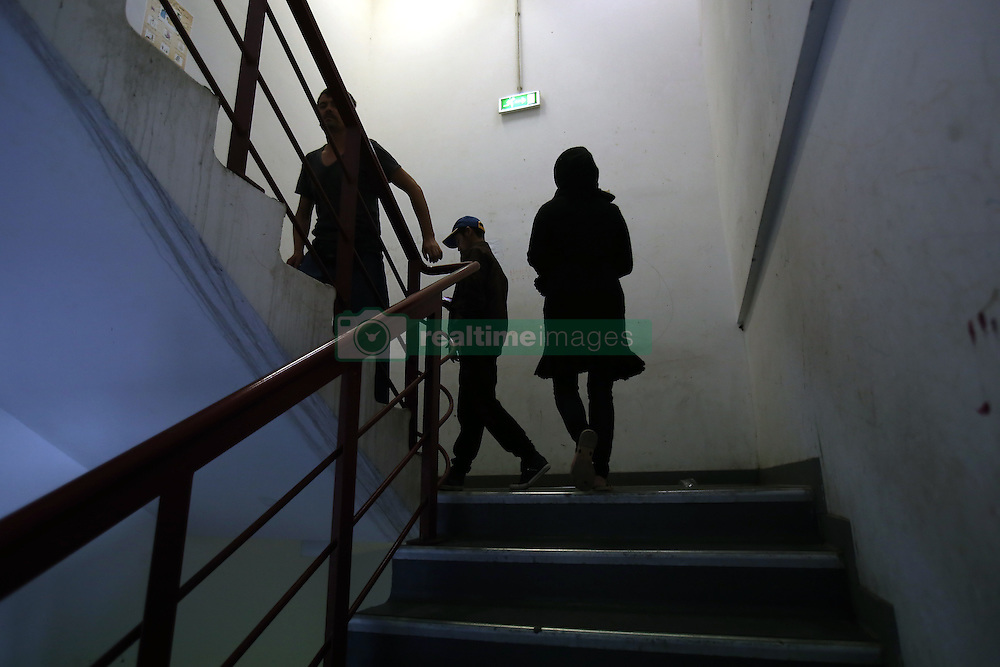 October 5, 2016 - Athens, Greece - Migrants inside a sports facilities in a former olympic complex at the former Athens airport of Athens, Greece on October 5, 2016.Almost 2,500 migrants and refugees, mainly Afghani, are housed at the former Athens airport site, and to an olympic complex used in the 2004 Olympics. In total 60.736 refugees and other migrants are stranded in Greece. (Credit Image: © Panayiotis Tzamaros/NurPhoto via ZUMA Press)