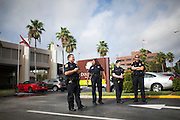 Police watch protesters outside of the DoubleTree Hotel, where John Boehner was scheduled to appear, at day 2 of the RNC in Tampa, FL, on Tuesday, Aug. 28, 2012...Photograph by Andrew Hinderaker for TIME.