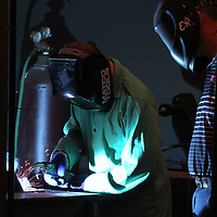 Caleb Carroll, 14, of Mooreville, practices Fillet Welding in his booth as instructor Jeff Franks stands by during ICC Advanced Manufacturing Camp on Wednesday in Belden. The camp is a technical, hands-on experience to introduce students to 21st century manufacturing technology and basic entrepreneurial skill.