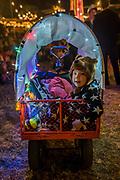 A young boy enjoys his illuminated trailor - The 2017 Glastonbury Festival, Worthy Farm. Glastonbury, 22 June 2017