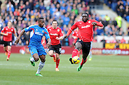Cardiff city's Kenwyne Jones &reg; breaks away from Hull city's Maynor Figueroa. Barclays Premier league, Cardiff city v Hull city match at the Cardiff city Stadium in Cardiff, South Wales on Saturday 22nd Feb 2014.<br /> pic by Andrew Orchard, Andrew Orchard sports photography.