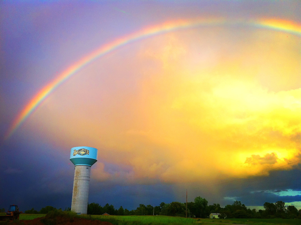 Rainbow over Bellevue water tower. Shot with iPhone 4, enhanced using Pro Camera app's Pro FX, lush setting. (Sam Lucero photo)