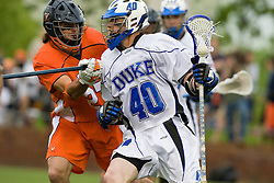 Virginia defenseman Ken Clausen (27) checks Duke attackman Matt Danowski (40).  The #2 ranked Duke Blue Devils defeated the #3 ranked Virginia Cavaliers 11-9 in the finals of the Men's 2008 Atlantic Coast Conference tournament at the University of Virginia's Klockner Stadium in Charlottesville, VA on April 27, 2008.
