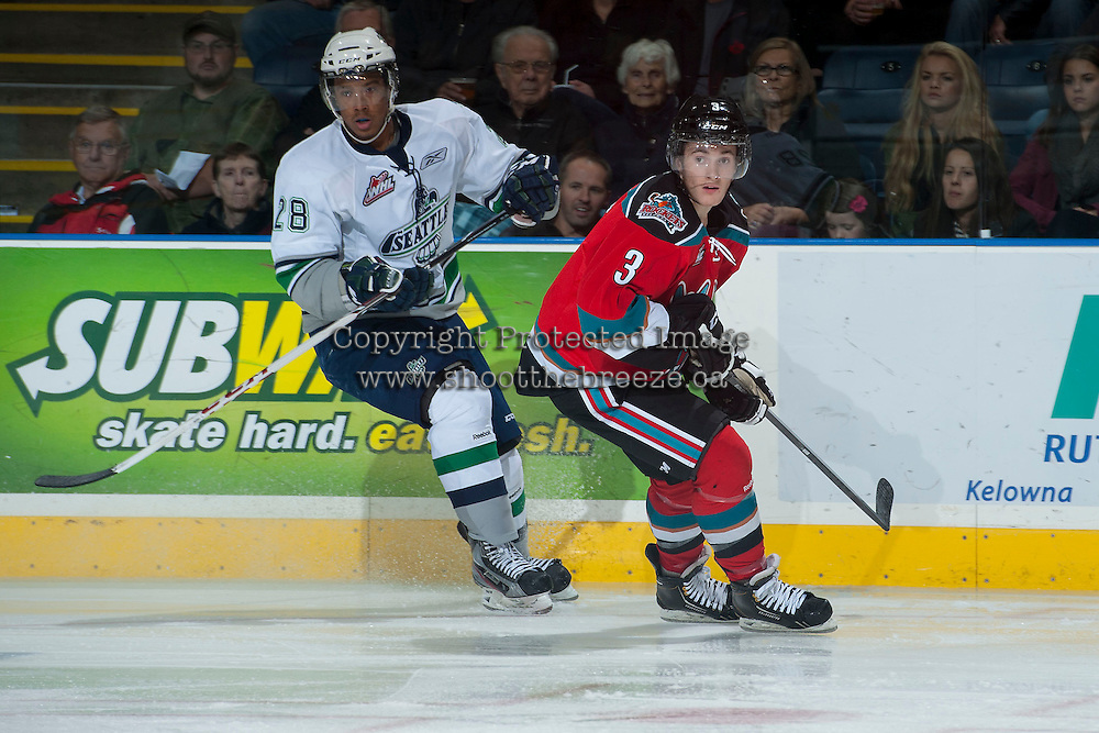 KELOWNA, CANADA - OCTOBER 11:   Riley Stadel #3 of  the Kelowna Rockets is checked by Keegan Kolesar #28 of the Seattle Thunderbirds on October 11, 2013 at Prospera Place in Kelowna, British Columbia, Canada (Photo by Marissa Baecker/Shoot the Breeze) *** Local Caption ***