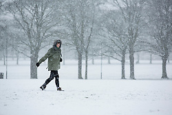 © Licensed to London News Pictures. 14/01/2013. London, United Kingdom ..A woman walks through the snow across Victoria Park in Leicester...Photo credit : Chris Winter/LNP