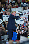 Republican presidential candidate billionaire Donald Trump surrounded by supporters during a campaign rally at the Myrtle Beach Convention Center November 24, 2015 in Myrtle Beach, South Carolina.