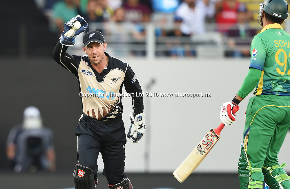 Sohaib Maqsood is caught behind by Luke Ronchi as Ronchi celebrates at the Twenty20 match between New Zealand Black Caps and Pakistan at Eden Park in Auckland, New Zealand. Friday 15 January 2016. Copyright photo: Andrew Cornaga / www.photosport.nz