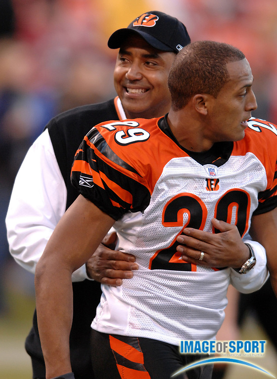 Dec 15, 2007; San Francisco, CA, USA; Cincinnati Bengals coach Marvin Lewis hugs Leon Hall (29) before game against San Francisco 49ers at Monster Park. Mandatory Credit: Kirby Lee/Image of Sport-US PRESSWIRE